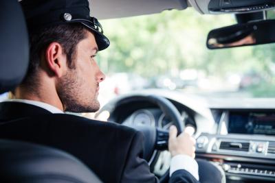 portrait of male chauffeur riding car