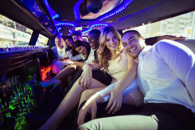 friends chatting in limousine on a night out