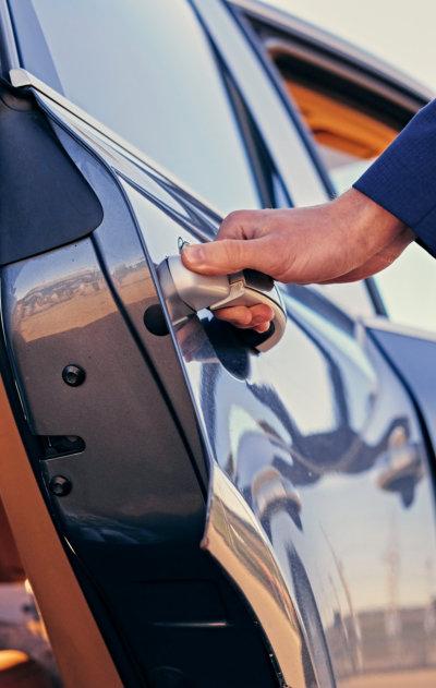 close up image of a man opens car's door