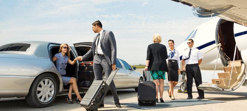 man in grey tuxedo escorting lady outside limousine