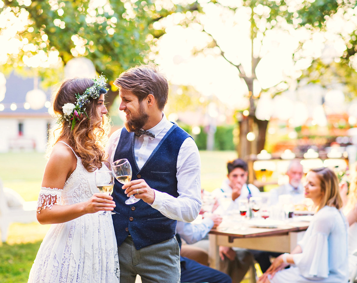 couple dancing while holding wine glass