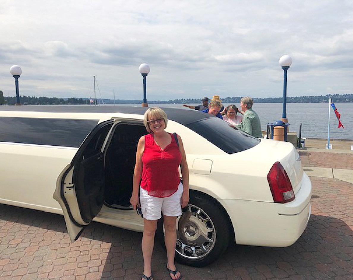 beautiful lady standing outside limousine