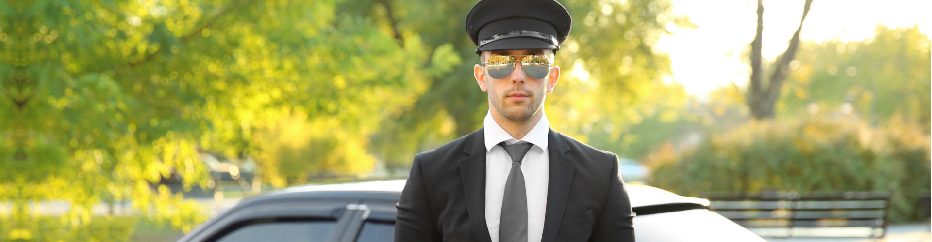 limousine driver standing