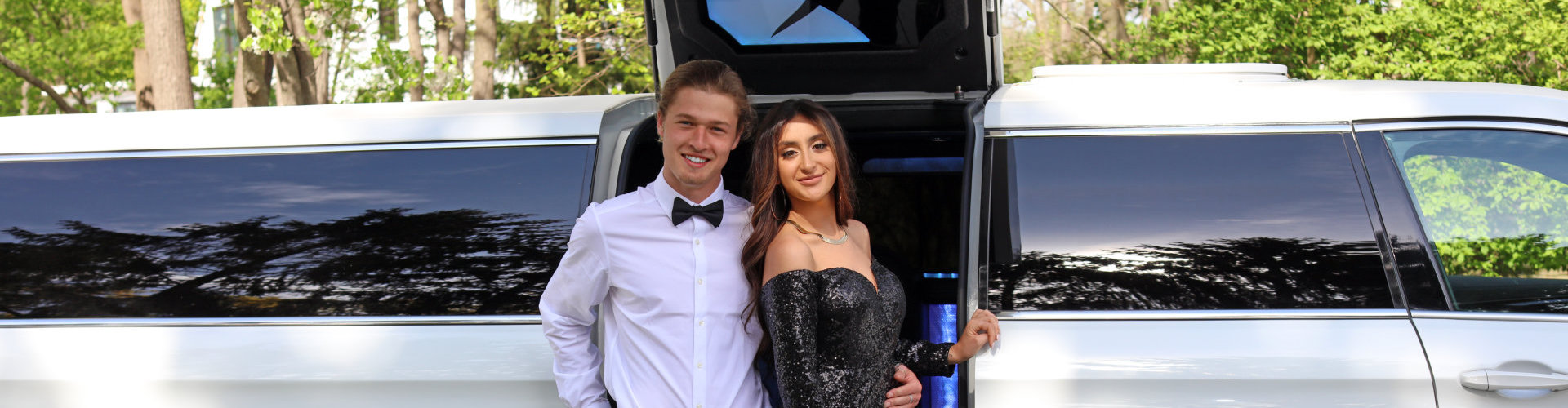 couple standing outside limousine