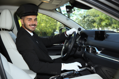 driver in luxury car